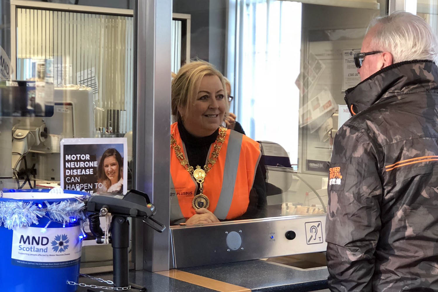 Provost Lorraine Cameron selling tickets in Johnstone Station