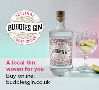 Bottle of Buddies Gin with glass, gin and lemon